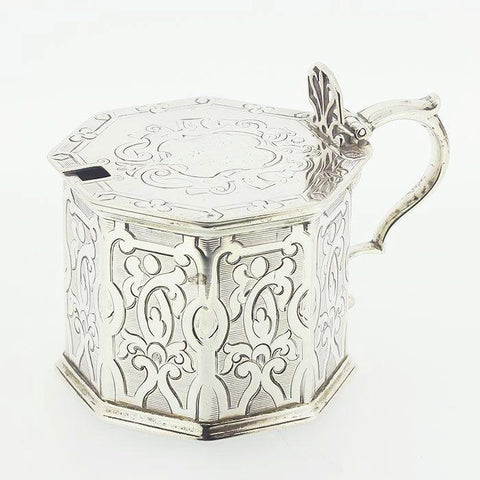 a victorian solid sterling silver mustard pot octagonal shape with blue glass liner maker Barnard and Sons with full hallmark