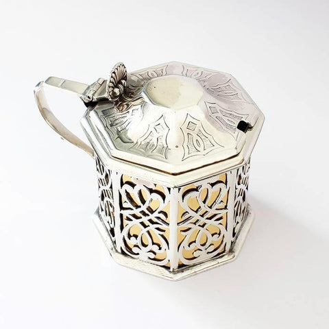 an antique silver and gilt inner mustard pot with cut out design and octagonal shape hallmarked 1850 and 1837