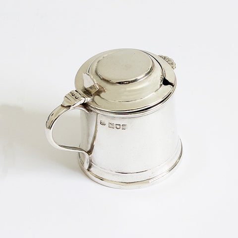 a silver mustard pot with blue glass liner dated london 1927 full hallmarked
