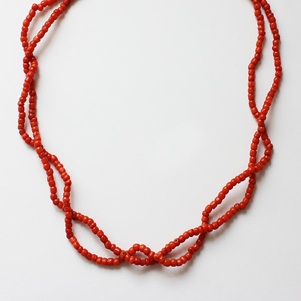 a coral double strand bead necklace with bolt ring clasp