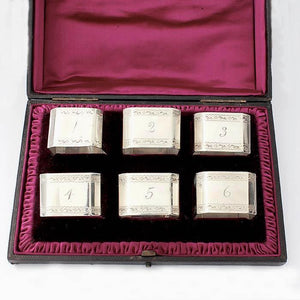 a set of 6 octagonal victorian silver napkin rings in their original presentation box and number 1 to 6 with motif and hallmark London 1887