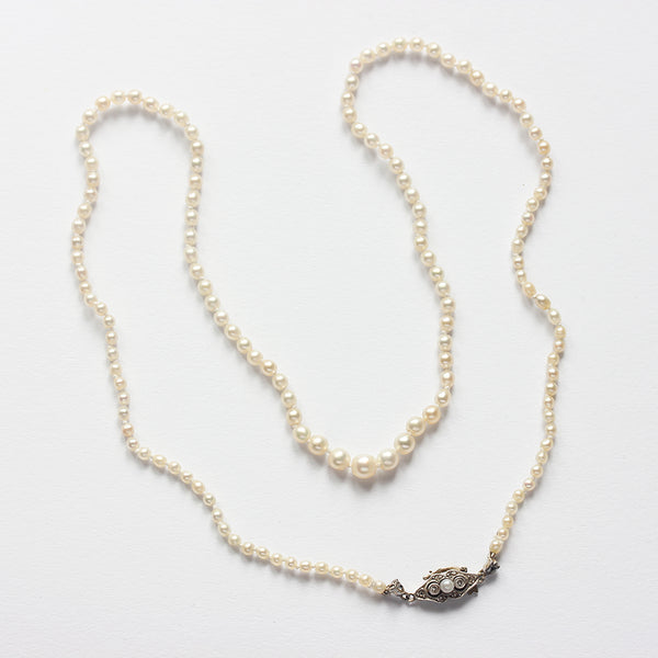 an antique natural pearl necklet with a diamond and pearl clasp at marston barrett in lewes