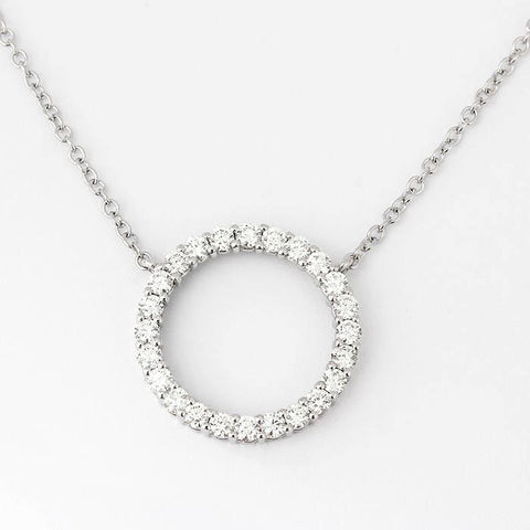 24 round diamonds in a circular open cut pendant with claw settings and a belcher chain all in white gold