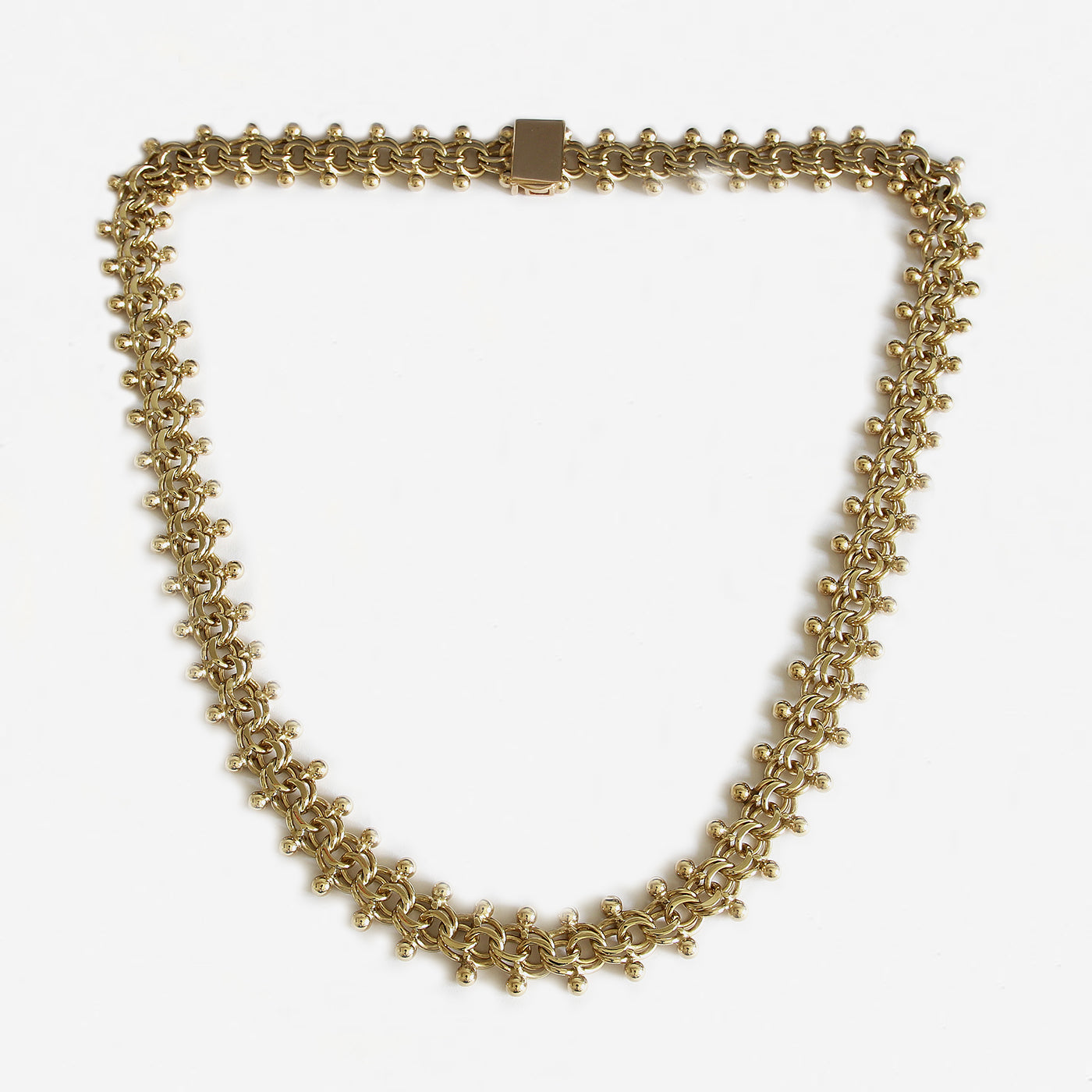 a secondhand vintage bead and curb link necklace in yellow gold