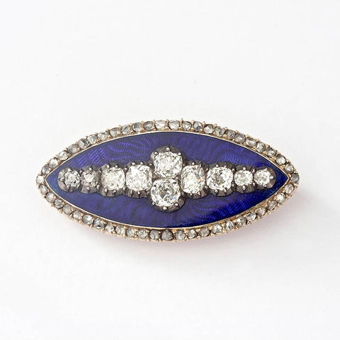 a beautiful diamond and blue enamel pointed oval brooch with silver and gold metal and original box
