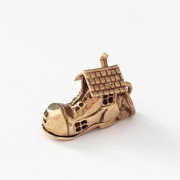 a secondhand yellow gold old lady in a shoe charm with opening feature and enamel