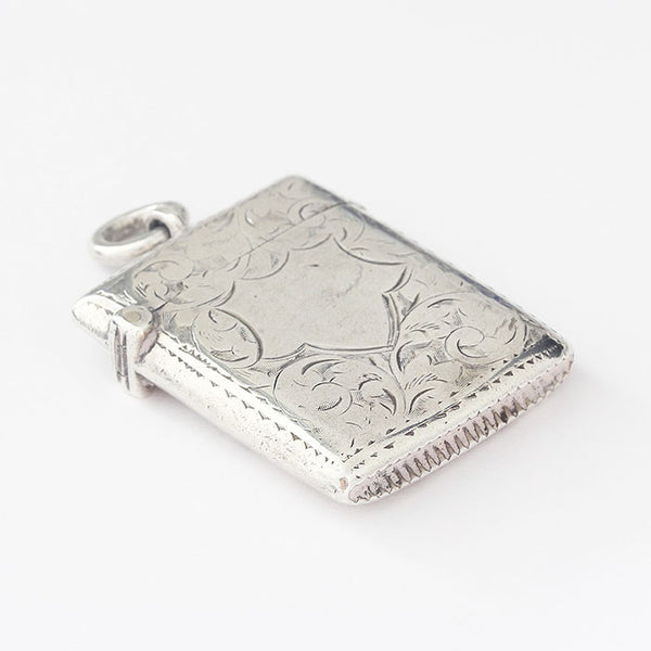 solid silver vesta case with floral design and plain shield