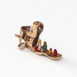 a 9ct yellow gold vintage old lady in a shoe charm with enamel
