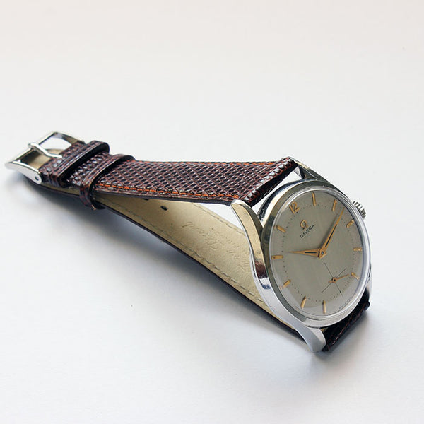 a vintage omega gents watch with brown strap