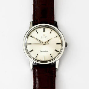 a secondhand mens omega vintage watch with stainless steel case and batons and a modern leather strap dated 1964