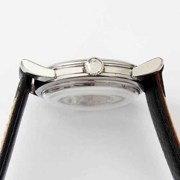 a preowned mens omega mechanical watch with a stainless steel case and leather strap dated 1957