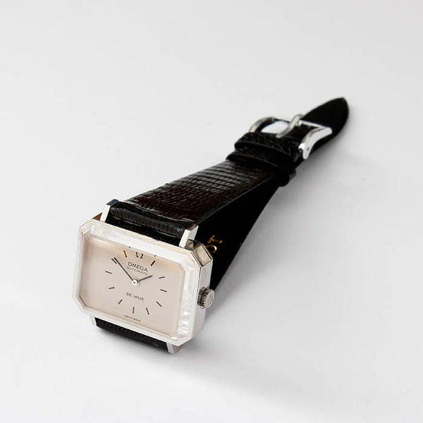 a vintage omega de ville automatic watch with a bevelled tv shape stainless steel case and a modern leather strap