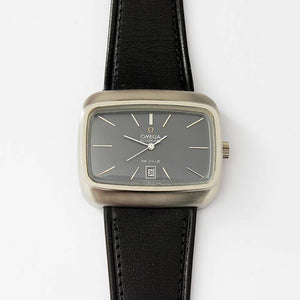 an omega automatic wrist watch de ville with a tv shape case and leather strap