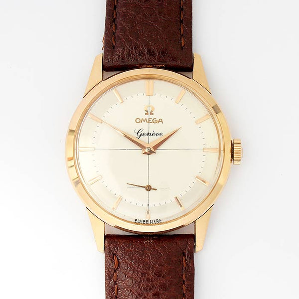 a vintage omega geneve 18 carat gold case watch with modern leather strap and 17 jewels hallmarked for 1960