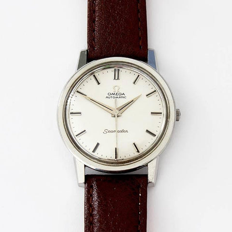 a preowned gents omega automatic wrist watch dated 1964 with leather strap and sea master model