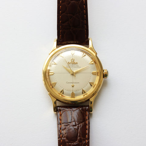 a preowned gents omega watch which is automatic and is a sea master model with brown leather strap