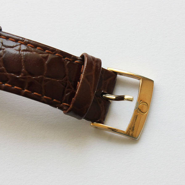 an original omega vintage mens watch with gold case and leather strap
