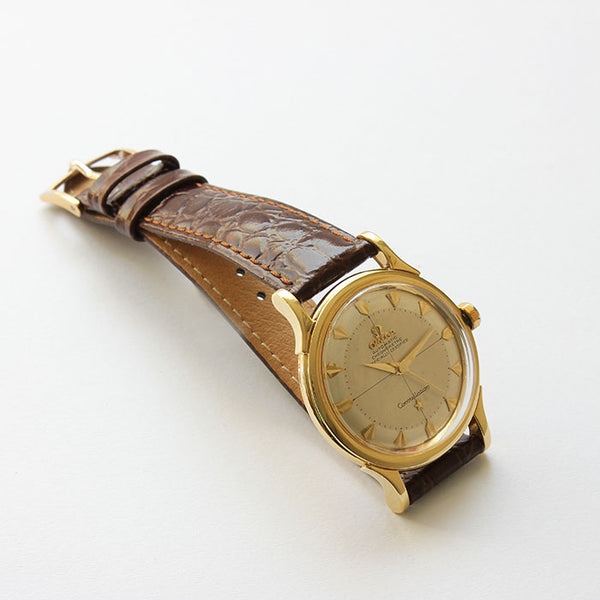 an omega vintage mens watch with gold case and brown leather strap and box