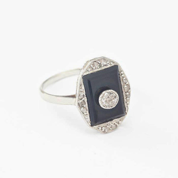 an onyx and diamond art deco design dress ring in an 18 carat and platinum band