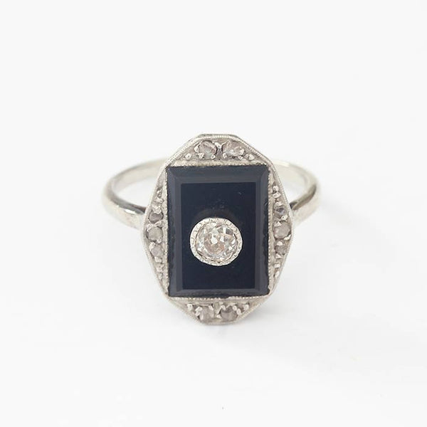 a beautiful onyx and diamond art deco dress ring in white gold and platinum