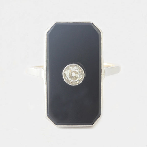 a stunning large onyx and diamond art deco ring in platinum and gold