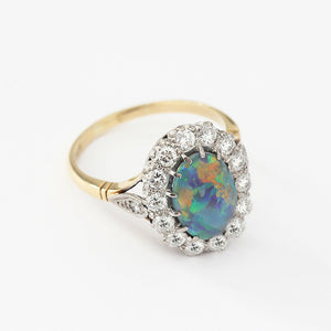 opal and diamond oval cluster ring in 18ct gold setting