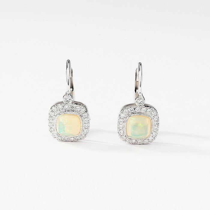 opal and diamond cluster earrings with a hook fitting set in white gold