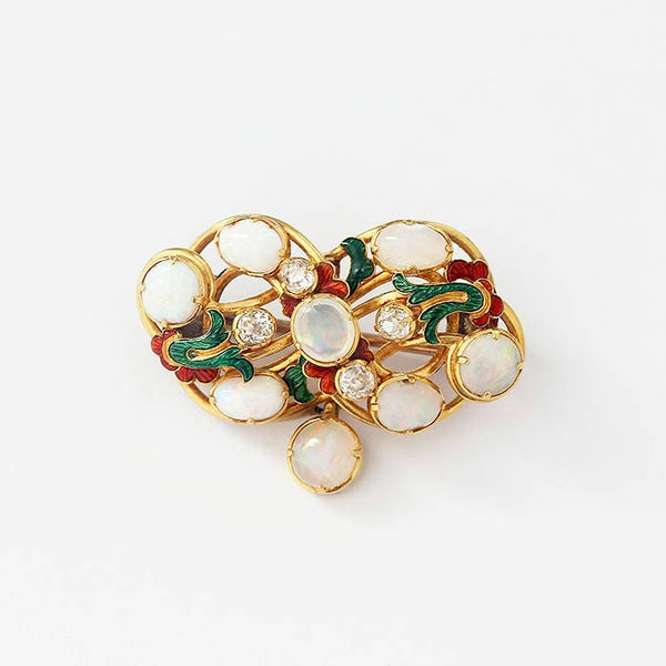 an 18 carat yellow gold vintage brooch with red and green enamel with opals and diamonds in a heart shape