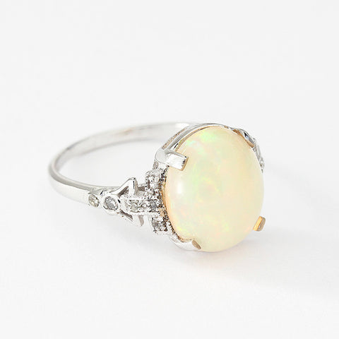 oval opal and diamond claw set ring set in 18ct white gold