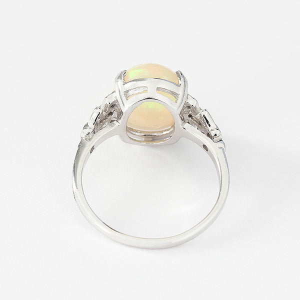 opal and diamond set ring with a white gold band