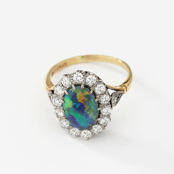 cluster ring in 18ct gold opal and diamond set