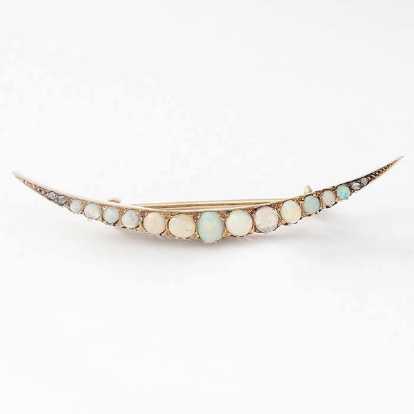 a beautiful opal crescent shaped yellow gold preowned brooch