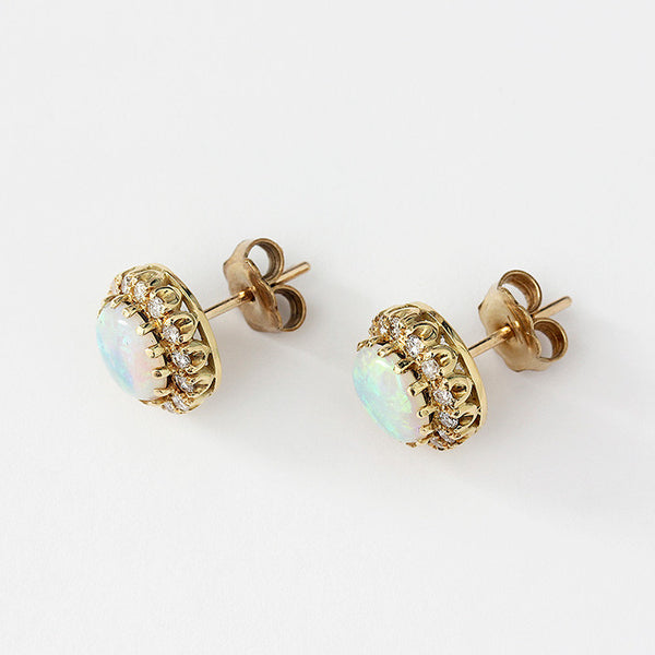 opal and diamond round cluster stud earring in 9ct yellow gold with claw settings