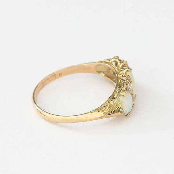 a secondhand yellow gold vintage design oval opal and diamond ring