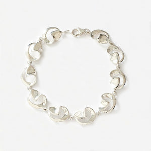 a sterling silver bracelet with openwork swirl design links and a plain trigger clasp