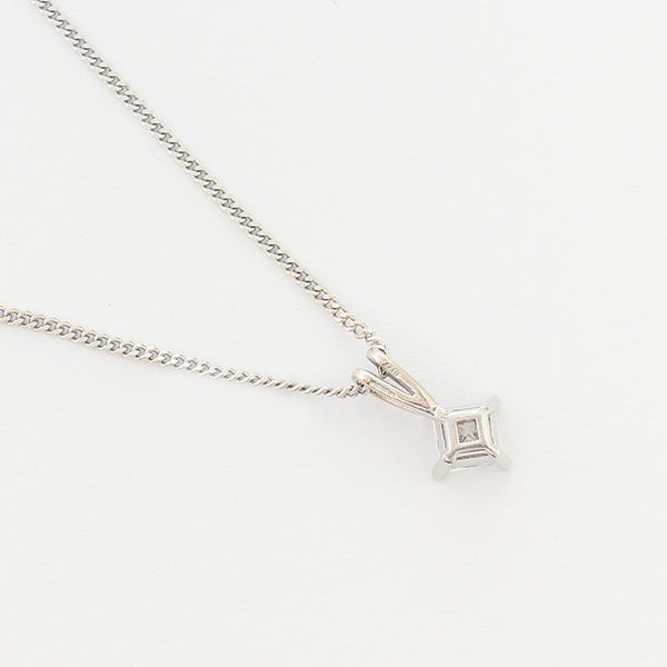 a white gold square shaped diamond single stone pendant and necklace