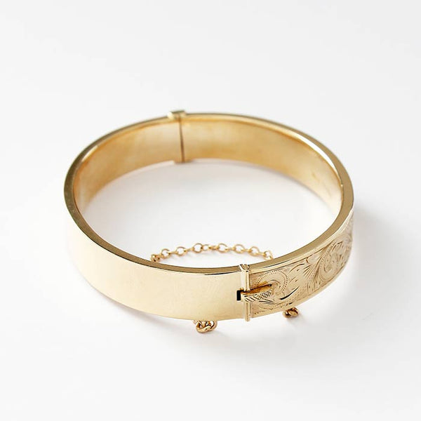 a secondhand yellow gold part engraved scroll design bangle with safety chain