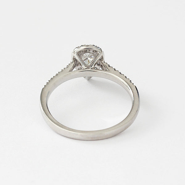 a platinum diamond cluster engagement ring in a claw setting