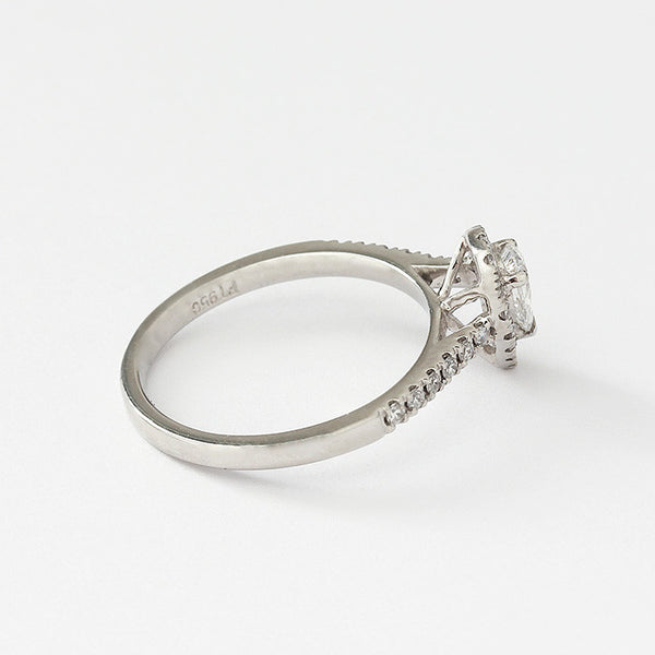 a diamond cluster ring in platinum with diamond shoulders all claw set