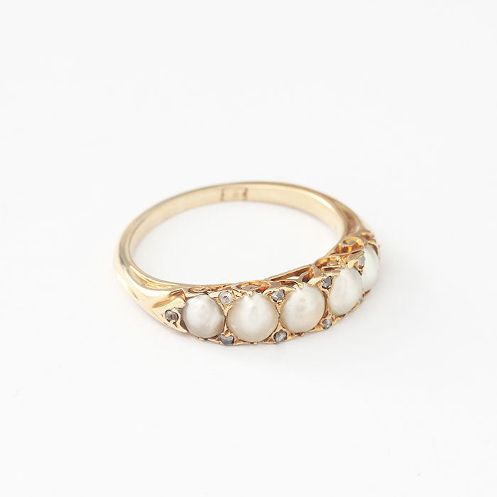 pearl and diamond half hoop ring in yellow gold with a carved design head