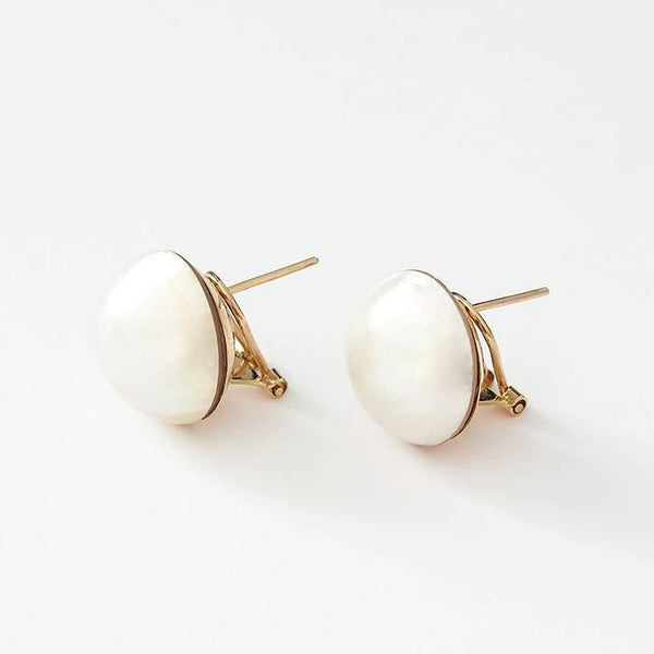 a secondhand pair of mabe pearl clip on earrings in yellow gold stamped 750