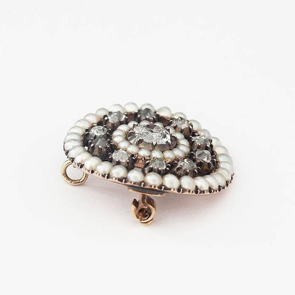 a secondhand pearl and diamond target round brooch in a cluster design