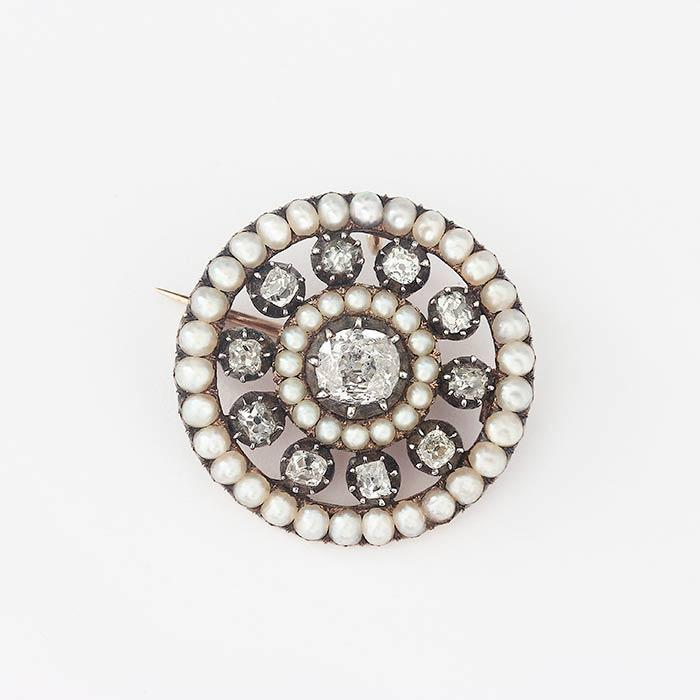 a beautiful secondhand pearl and diamond cluster target brooch with a yellow gold reverse