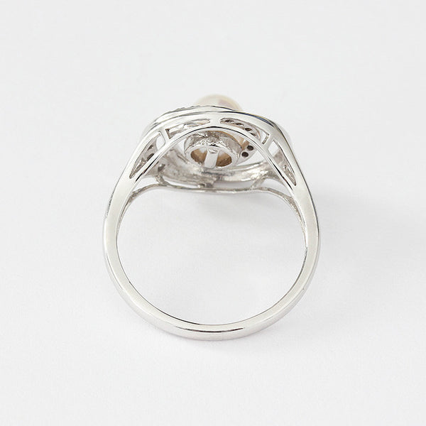 modern ladies pearl and diamond ring in white gold