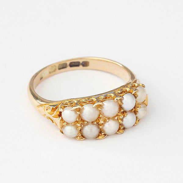 a secondhand victorian pearl ring with a carved shoulder design yellow gold