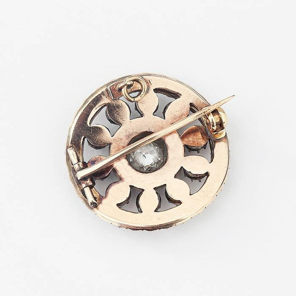 a preowned diamond and pearl cluster target design brooch in yellow gold
