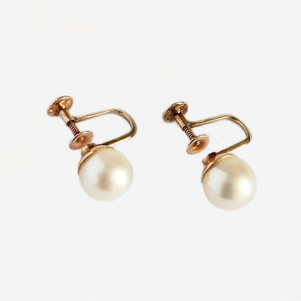 a secondhand set of pearl stud earrings with gold screw fittings
