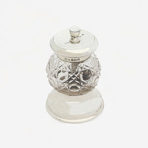 an Edwardian silver and glass pepper mill by Peugeot dated 1902