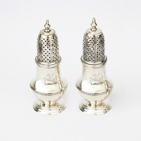 a silver pair of peppers dated london 1749 and with a roped edge
