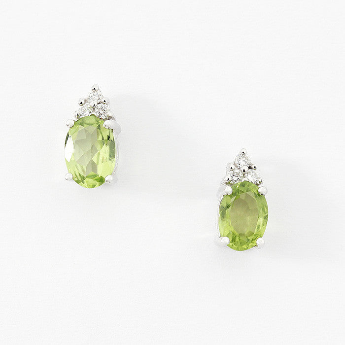 peridot and diamond oval claw set stud earrings in 18ct white gold